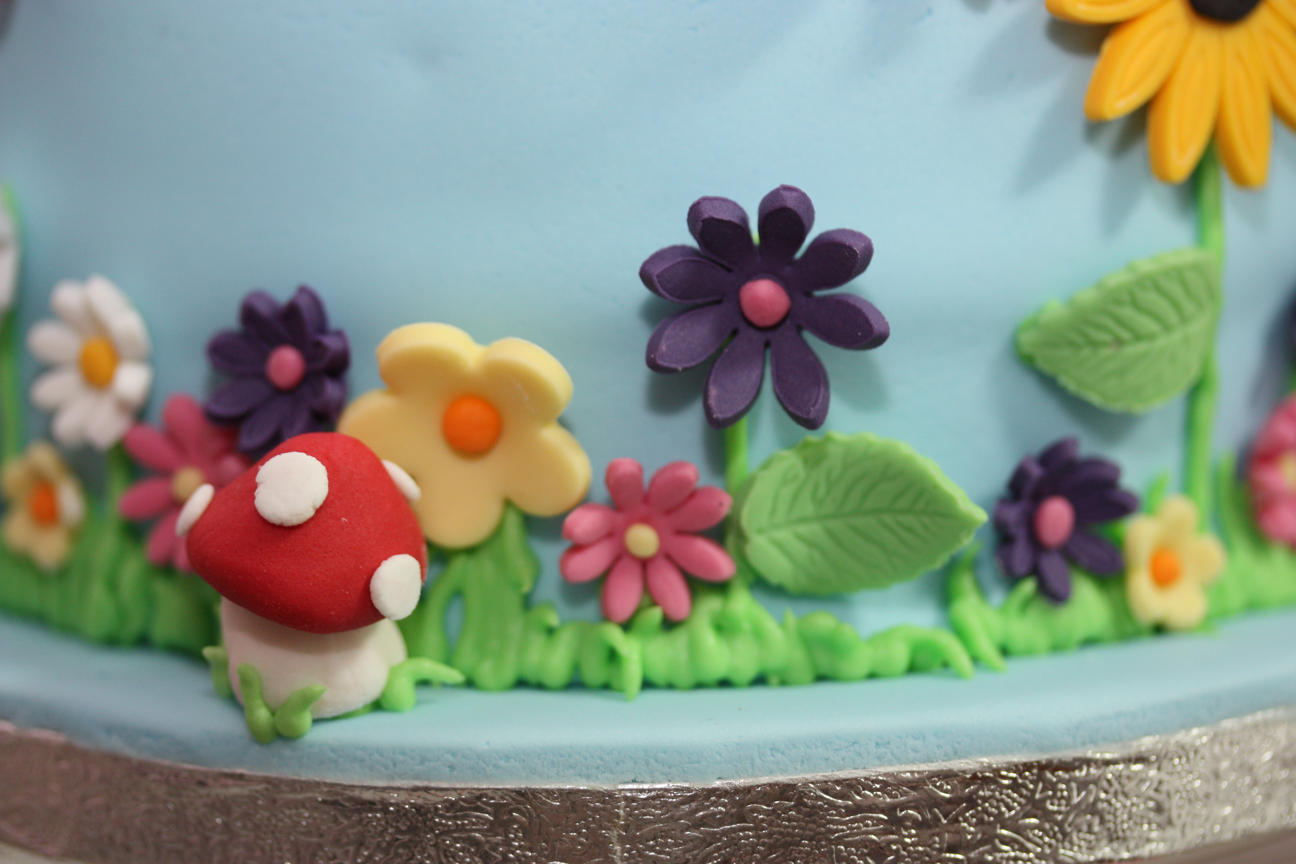 Garden birthday cake opulent cakes for all occasions a garden theme birthday cake came to mind i included in mushrooms bees butterflies and flowers everyone was delighted with the cake all chocolate izmirmasajfo